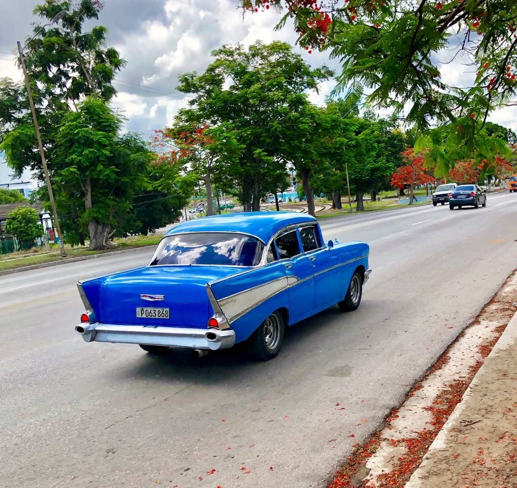 streets of havana blue antique car